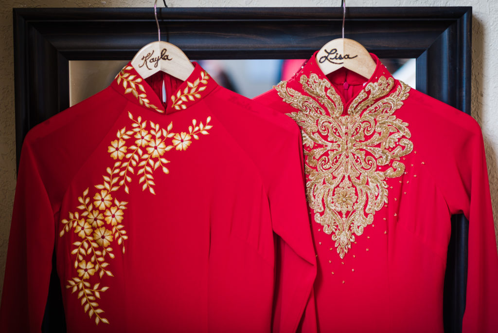 Traditional Asian wedding gowns at a sister's double wedding